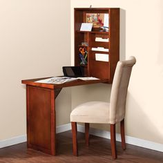 "The Space Saving Foldout Desk - This desk folds to only 6"" and stores in an unobtrusive wall-hung cabinet. When open, the 30""-wide x 20""-deep desktop provides ample space for a laptop, note pad, and writing implements. The interior of the cabinet has two adjustable and two stationary shelves, three file-holding compartments, and a cork board, allowing you to keep bills, paper work, and notes organized whether the unit is open or closed."