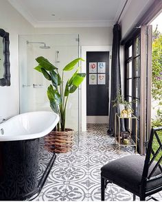 So pretty it stopped us in our scroll! #instalove the touches of #blackandwhite with #green leaves and #pattern #tile! Bravo @kimstephen_interiors on the #bathroomdesign & thanks to @reedharristiles for sharing the loveliness! / #tiletuesday #tiles #interiordesign #designhounds #ihavethisthingwithtiles #tileaddiction #bathroomgoals #soakingtub #homedecor
