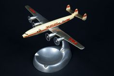 TWA (Trans World Airlines) Lockheed Model 1649 Starliner model aircraft ashtray  c. 1957   Riffe Models, Kansas City, Kansas   metal, paint, plastic   SFO Museum.  I really like the simulated propellers-in-motion on this model.