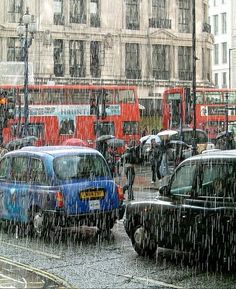 """Pouring Rain, London, England photo via sandra -- despite my great passion for Great Britain, I continue to find it extremely curious that they say """".pouring with rain. Walking In The Rain, Singing In The Rain, Places To Travel, Places To See, London In March, London Rain, I Love Rain, England And Scotland, England Uk"""