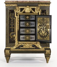 Cabinet is an example of the high regard in which boulle marquetry cont'd to be held in France thoughout the 18th century. The technique, which involves cutting patterns in multiple layers of turtle shell, brass and other materials (here pewter and horn) got its name from Louis XIV's cabinet maker, André-Charles Boulle (1642-1732). He was not the only, but the best-known practitioner of the technique, Paris, France, ca. 1780-1790