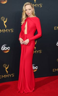 PORTIA DOUBLEDAY wears a lipstick-red custom Giorgio Armani gown with a major keyhole cut-out and draping at the waist, plus Sylvia & Cie jewelery.