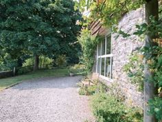 Enjoy a cottage holiday at Spring Cottage. The views from Spring Cottage are by no means seasonal; Dog Friendly Holidays, Dog Friends, Sidewalk, Cottage, Exterior, Spring, Plants, Side Walkway, Cottages