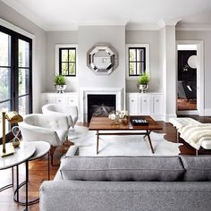 The Design Company   Living Rooms   Gray Wall Color, Hardwood Floors,  Marble Fireplace Surround, White Cabinet.
