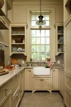This outdoor summer kitchen features a Rohl Farm house sink that fits perfectly in this small space.