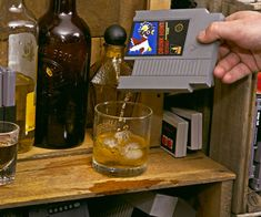 Nintendo Game Cartridge Flasks - Want some pixelated vodka? An 8-bit .08 BAC? With these NES cartridge flasks nostalgic favorites like Super Mario Bros., Duck Hunt, and Mega Man become portals not only to good time gaming marathons on Saturday night... / TechNews24h.com