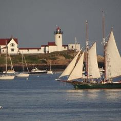 The Schooner Lannon passing Eastern Point Light,  Dogbar Breakwater, Gloucester MA; Photo by Renata Greene