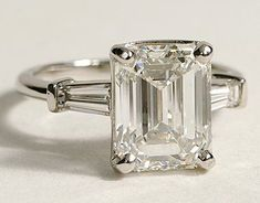 The perfect engagement ring: A simple emerald cut diamond framed by baguettes. #DazzlingDiamondEngagementRings