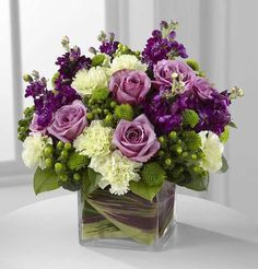 The Beloved Bouquet is a compact arrangement of green and purple flowers designed in a leaf lined square vase hand delivered by a local flower shop. Wood Flower Box, Flower Boxes, Flower Ideas, Flower Designs, Wedding Flower Arrangements, Floral Centerpieces, Purple Wedding Centerpieces, Branch Centerpieces, Large Floral Arrangements