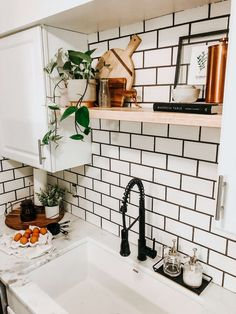 This modern farmhouse kitchen is full of black and white decor, accents of greenery, marble countertops and a custom shiplap island! Home Decor Kitchen, Kitchen Interior, New Kitchen, Island Kitchen, White Kitchen Decor, Awesome Kitchen, Apartment Kitchen, Design Kitchen, Subway Tile Kitchen