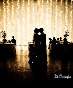 Backdrop is tulle and string lights