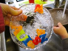 Freezing letters and numbers to discover how to melt ice (science), to do math problems and to recognize letters and spell words. From Creekside Learning.