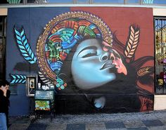 El Mac (or The Mac) is a Los Angeles born artist who's been studying art since childhood. He draws inspiration from LA's Mexican and Chicano culture as well as from pin-up and religious art. We love his photorealistic depiction of women and how uses color. Creating unique and one-of-a-kind murals and graffiti, he's been commissioned …