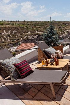 The restaurant terrace features a firepit and a chill-out area strewn with cushions. The House Hotel Cappadocia (Cappadocia, Turkey) - Jetsetter