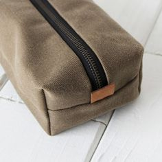 Waxed Canvas Dopp Kit - Tan or Olive - grab one at: https://cloakanddapper.us/waxed-canvas-dopp-kit-tan-or-olive.html