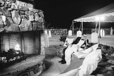 How relaxing and romantic. Outdoor wedding reception with fireplace. Love this! #jandmevents #eventplanning #evententertainment