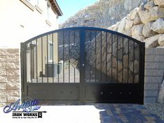 Wrought iron driveway gate with perforated metal backing Gate Wall Design, Wrought Iron Driveway Gates, Perforated Metal, Entry Gates, Outdoor Stuff, Yard Ideas, Home Deco, Fence, House Ideas
