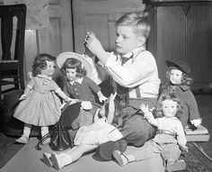 "A boy and his collection of hard plastic dolls, (all made by American Character and known colloquially in collecting circles as ""Pre-Sweet Sue dolls""), New York, 1950."