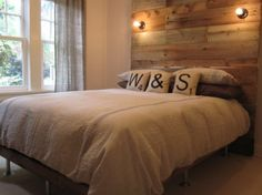 This headboard from Mrs. Fancy Pants uses reclaimed fence boards, and actually has lighting attached that gives it an industrial look. Isn't that a great look? (SCRABBLE PILLOWS!!)