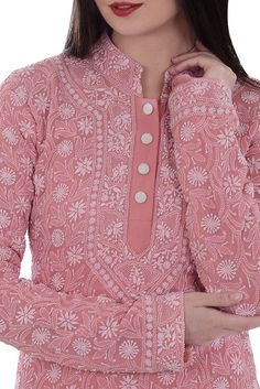 This is a salmon pink pure georgette hand embroidered all over intricate chikankari kurta. The kurta has ivory chikankari floral jaal all over front, back and sleeves. The kurta has a band collar and 7 inches long front open plackett with hook cl Salwar Neck Designs, Kurta Neck Design, Neck Designs For Suits, Neckline Designs, Kurta Designs Women, Dress Neck Designs, Blouse Designs, Indian Dresses, Indian Outfits