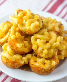 Mini Macaroni and Cheese Bites are the perfect cheesy, appetizer! Everyone loves this quick and easy appetizer recipe! Perfect game day food!