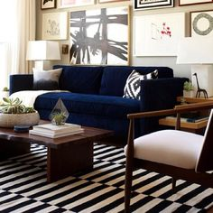 blue couch, gallery wall, gold, dark wood...