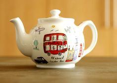 London Travel Teapot   Iconic London locations from drawings by James Sadler, just in time for the upcoming 2012 Olympic games.