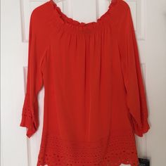 """NWT 100% Silk Anne Klein Off Shoulder Blouse. NWT Gorgeous off the shoulders Anne Klein 100% Silk Blouse in Orange Color and embroidered hem and sleeves.  Size M Measurements: laying flat 20"""" Chest  28"""" Length  14"""" Sleeve Length                                                No trade, no holding, no off sight payment Anne Klein Tops Blouses"""