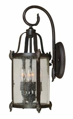 World Imports 1693-89 Old Sturbridge Collection 4-Light Outdoor Wall Lantern, Bronze by World Imports. $123.14. From the Manufacturer                Detail is evident in this outdoor wall lantern. It's Bronze finish, champagne seedy glass side panels and amber seedy top bent glass panels balance formal with casual. A great look for any home.                                    Product Description                One of World Imports best selling foyer families is now availab...