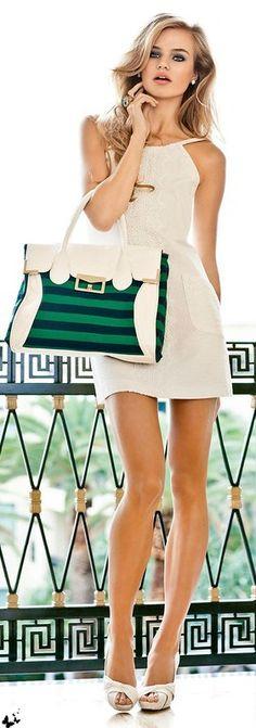 white mini skirt dress with leather handbag