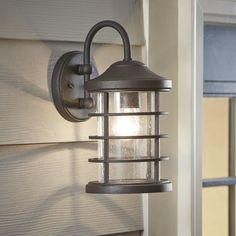 This lantern-style wall sconce provides a handsome look that works with a variety of exterior styles.