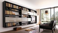 MisuraEmme Futuristic Furnitures for Modern Living Room Designs Integrated Bookshelves with TV Cabinet for Entertainment Center Living Room Design by MisuraEmme – Home Designs and Pictures