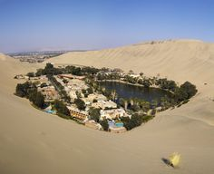 The Huacachina Oasis is an actual oasis and not a figment of your imagination. Image Source: Shutterstock
