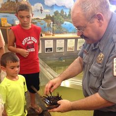 Ranger Mike Walker teaching young visitors at Huntington Beach State Park about #horseshoecrabs #scstateparks