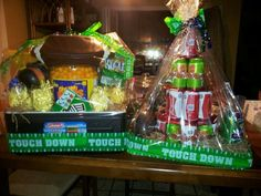 ice chest raffle. basket idea. ITEM on right is a beer/ soda cake on the lid of the ice chest. THE ice chest has 4 football shaped glasses with a football hat and the stuff inside is all u nee for football party( cheese balls, pretzels. CHipS.salsa and so onnn,