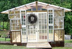 Greenhouse made of old windows.  My sister's husband made her one - it even had stained glass.