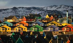 Houses are painted in bright colours in the town of Ilulissat in western Greenland.