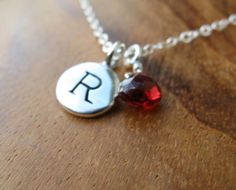 i want this exactly as is. letter R, garnet red stone.  so gorgeous.  26.50 from gomeagan on etsy.  so pretty.
