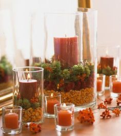 Make a pretty centerpiece or mantel decoration by layering seasonal materials in clear glass cylinder vases. More Thanksgiving decoration: http://www.midwestliving.com/holidays/thanksgiving/easy-ideas-for-thanksgiving-decorating/?page=13,0