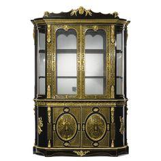 An English gilt-bronze mounted ebony veneered and brass inlaid mahogany Boulle marquetry vitrine cupboard, London, circa 1875.