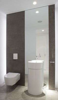 playing up bathroom height, tile + mirror wall, modern pedastal sink, by Magdalena Keck Interior Design Bathroom Spa, Bathroom Interior, Small Bathroom, Washroom, Spas, Modern White Bathroom, Small Wall Mirrors, Donia, Wall Mounted Toilet