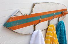 Who wouldn't want a shower made out of an old surfboard in their garden?