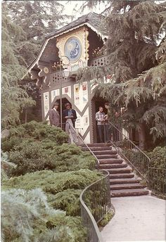 Waiting for the Skyway at the Swiss chalet Fantasyland station, circa 1963. The building is still there, but grown-over and roped off. Is it just storage now? I wonder!