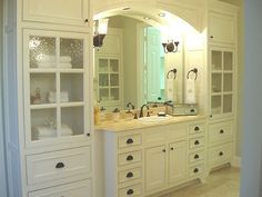 storage galore in the bathroom, and an arch to boot