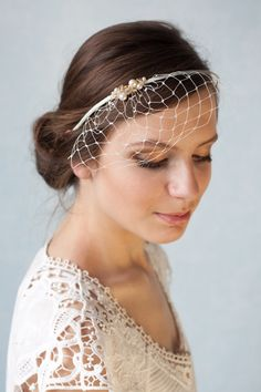 Bridal ivory birdcage veil with Swarovski pearls and crystals, beaded wedding veil, bridal birdcage headband. $38.00, via Etsy.