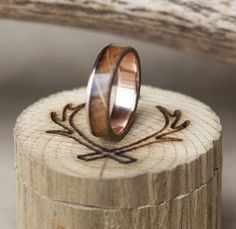 Rose gold and whiskey barrel men's wedding band.