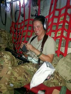 Don't know who this is but I love that she's knitting on a military transport!