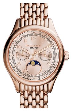 Obsessed with this rose gold Michael Kors moon watch because of the bold face and elegant strap. Styling tip: Pair it with a sparkly bracelet for a glam stacked wrist that could be worn at work out out to a fancy dinner.