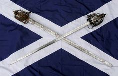 The original swords of Rob Roy MacGregor and his last opponent in single combat, Charles Stuart of Ardshiel.