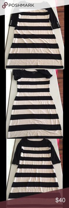 Tan/Black White House Black Market Striped Dress Light tan/black wide striped dress with three-quarter sleeves from White House Black Market. Like-new condition. Super flattering fit! 2nd picture shows the natural curve of the dress. Silver snap-buttons on the shoulders and bottom of the sleeves are the perfect accents to give it a little something extra! White House Black Market Dresses